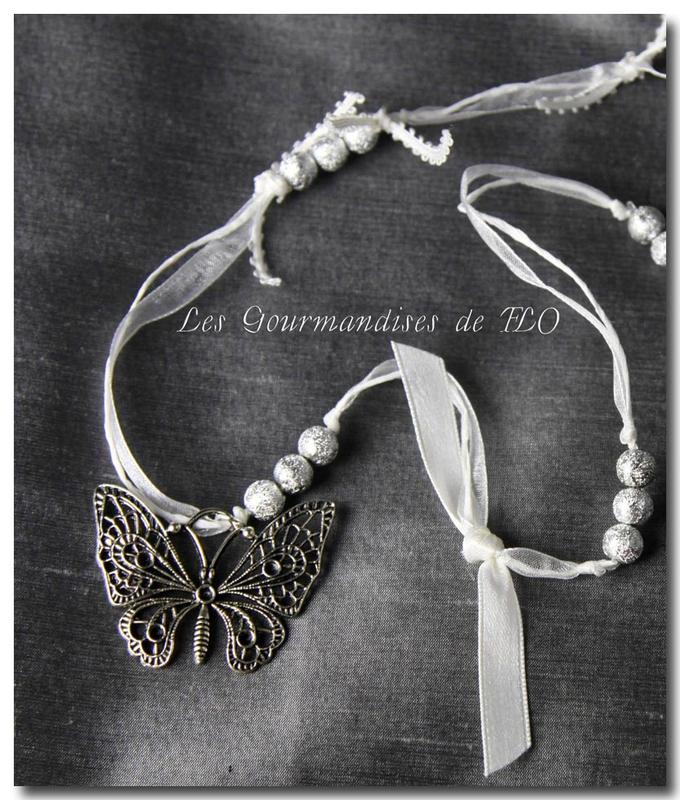 Collier papillon vole
